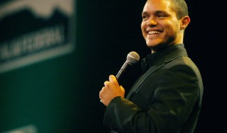 (FILES) A June 17, 2008 file photo shows South Africa Stand up comedian Trevor Noah performing at the SA cricket awards held at the Sandton convention centre in Johannesburg. Noah, who is not married and has been based in the US for about three years, is next due to perform live in South Africa for 15 concerts at the Teatro at Montecasino in Johannesburg between May 29 and June 28, 2015. AFP PHOTO/STRINGER