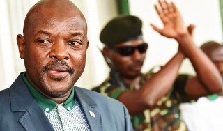 Burundi's President Pierre Nkurunziza looks at journalists at the President's office in Bujumbura on May 17, 2015. Nkurunziza made his first official appearance since an attempted coup against him this week. Burundi has seen weeks of violent and deadly street protests over his controversial bid to stand for a third consecutive term on office. He faced an unsuccessful coup attempt when top generals announced they were overthrowing him while he was on a visit to neighbouring Tanzania. AFP PHOTO / CARL DE SOUZA