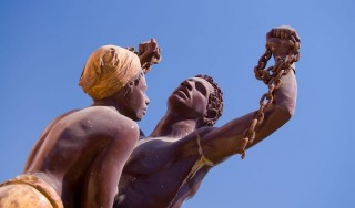 Travel, Senegal, Dakar, Statue of slave couple at slavery museum,