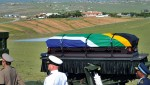 The coffin of the former president is escorted by the military to the compound for his funeral in Qunu
