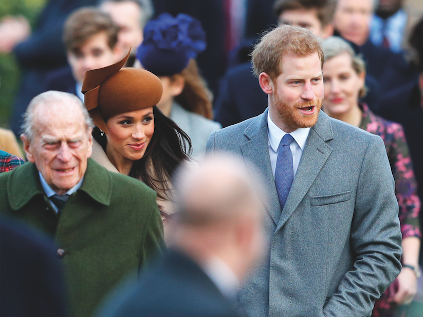 Meghan Markle and Prince Harry walk behind the Duke of Edinburgh