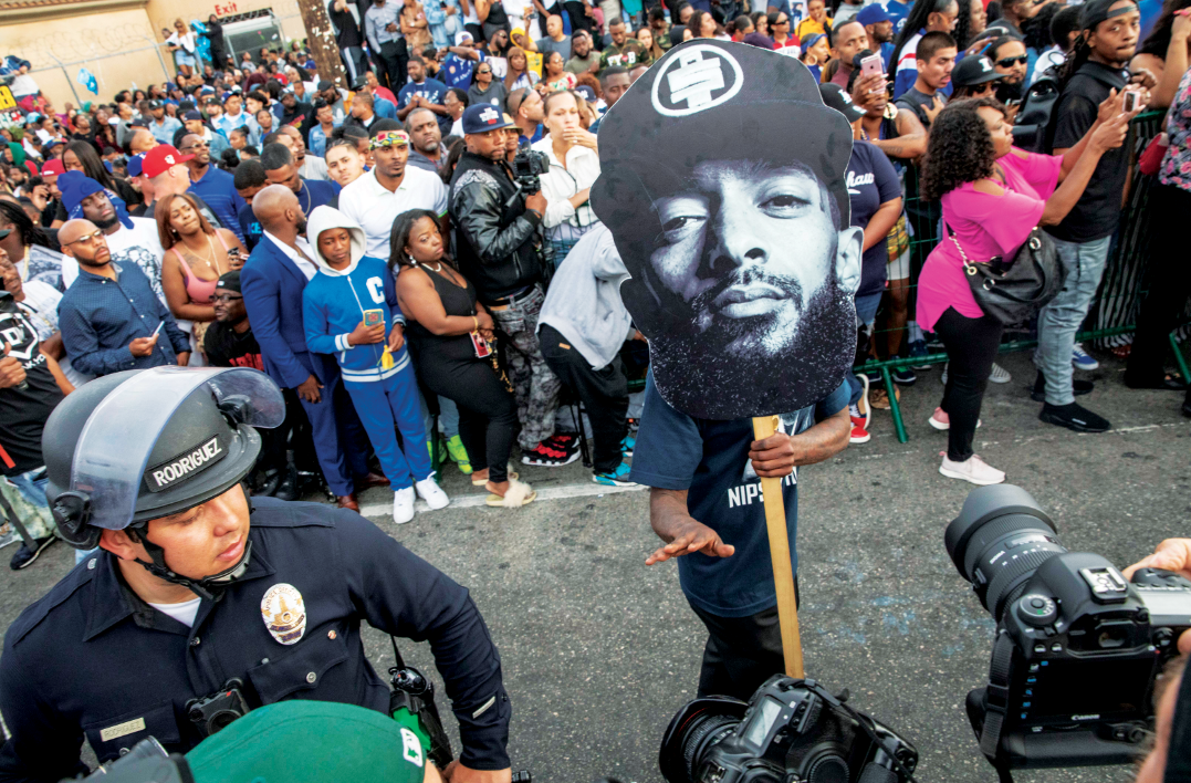 The procession for Eritrean/American rapper Nipsey Hussle passes his Marathon Clothing Store in LA, California