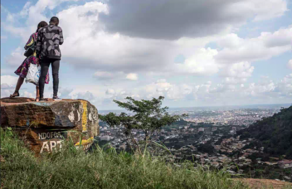 A couple admire the view of Yaoundé, the capital of Cameroon.