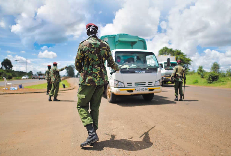 Soldiers checking for movement permits at a Nairobi border point in late April