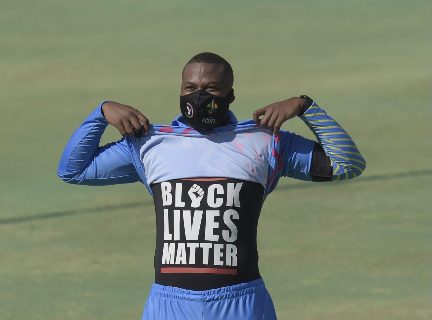 Cricketer Lungi Ngidi shows his shirt in solidarity with the global Black Lives Matter movement.