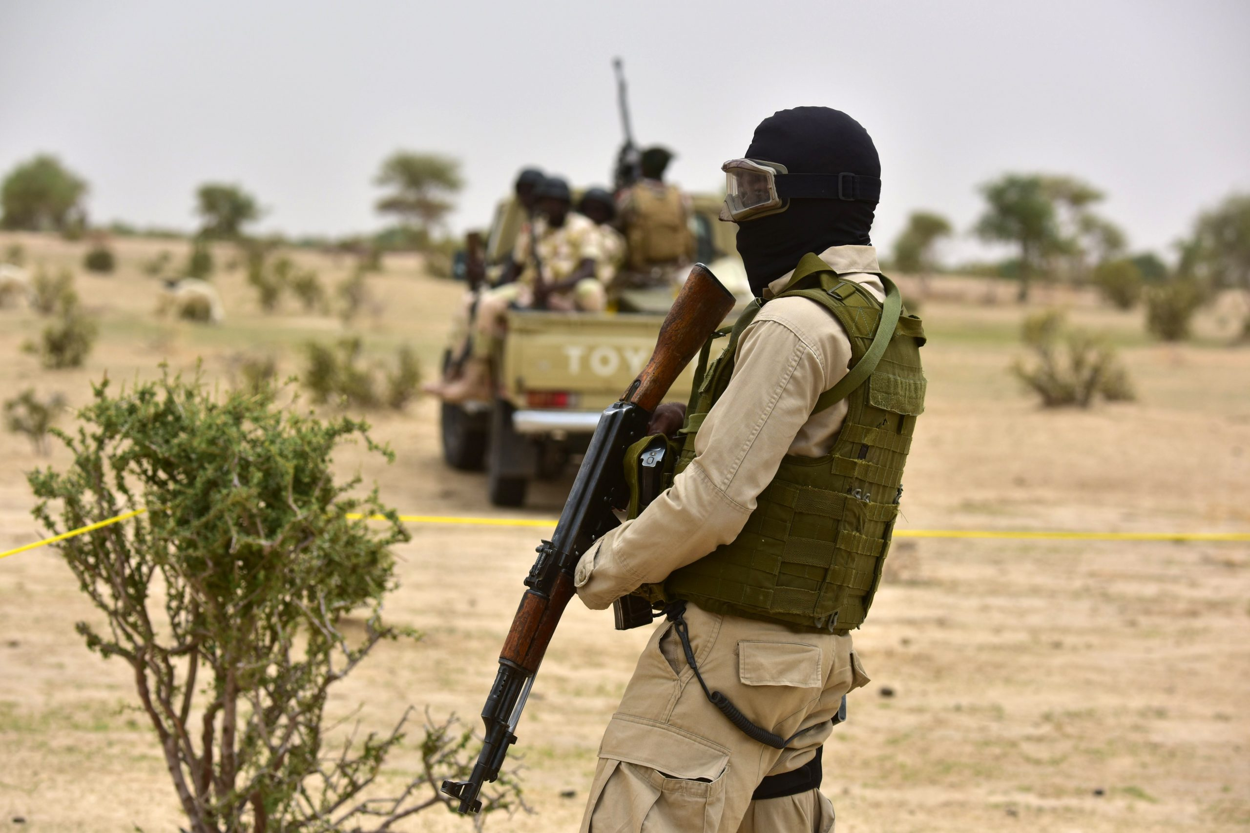 Hooded members of Niger's armed forces patrol during a visit of Niger's Interior Minister to a camp for displaced populations.