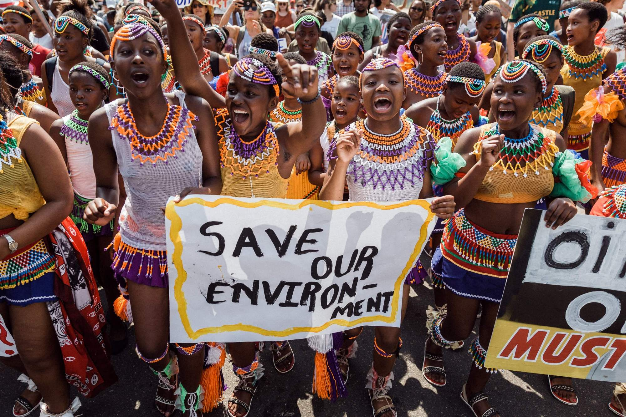 People take part in a protest for climate action on September 20, 2019 in Durban, as part of a Global Climate action day.