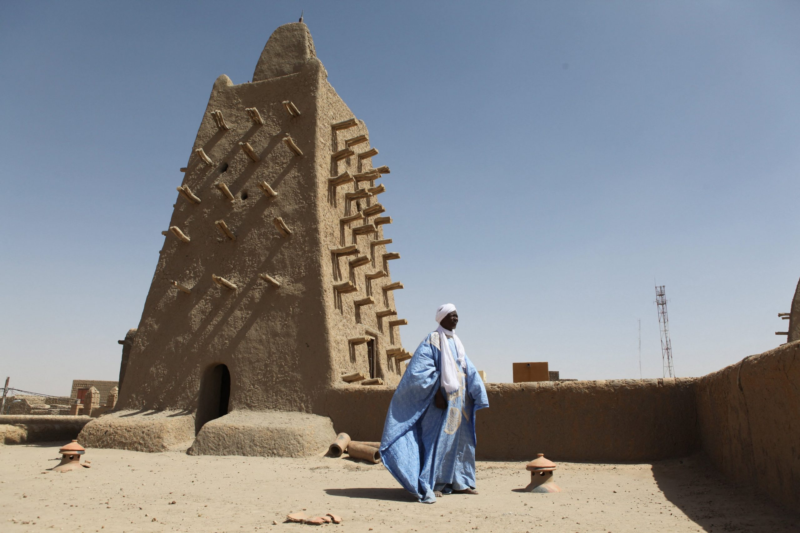 A man stands in front of the Djingareyber mosque in Timbuktu.